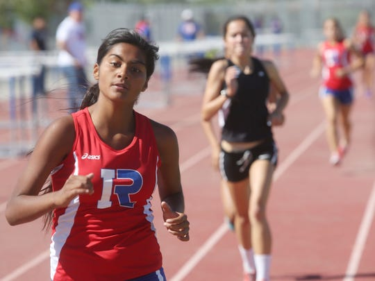 Indio High School student Regina Casas races to win the 1,600 race against Palm Springs during a track meet Thursday.