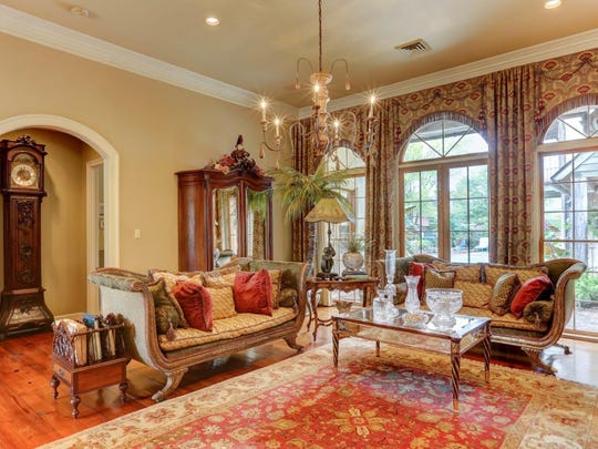 There are soaring ceilings and wonderful views in the living areas.