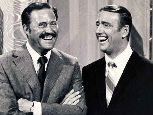 """Dan Rowan (left) and Dick Martin were the co-hosts of """"Rowan & Martin's Laugh-In,"""" which debuted on NBC in 1968 and by 1969, topped TV ratings."""