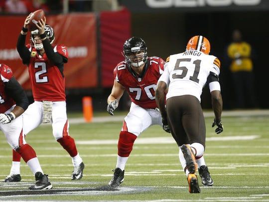 Atlanta Falcons tackle Jake Matthews (70) prepares