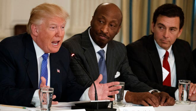 "In this Thursday, Feb. 23, 2017, photo, President Donald Trump, left, speaks during a meeting with manufacturing executives at the White House in Washington, including Merck CEO Kenneth Frazier, center, and Ford CEO Mark Fields. Frazier is resigning from the President's American Manufacturing Council citing ""a responsibility to take a stand against intolerance and extremism."" Frazier's resignation comes shortly after a violent confrontation between white supremacists and protesters in Charlottesville, Va. Trump is being criticized for not explicitly condemning the white nationalists who marched in Charlottesville."