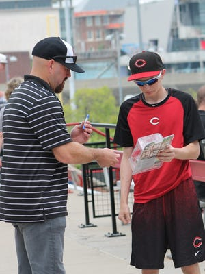 Former University of Cincinnati and Major League Baseball player Kevin Youkilis signs an autograph for a fan May 16 at Marge Schott Stadium. The Bearcats retired the No. 36 of Youkilis.