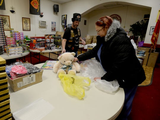 Ron Ross and Ann Hunsinger prepare toys for the Toys