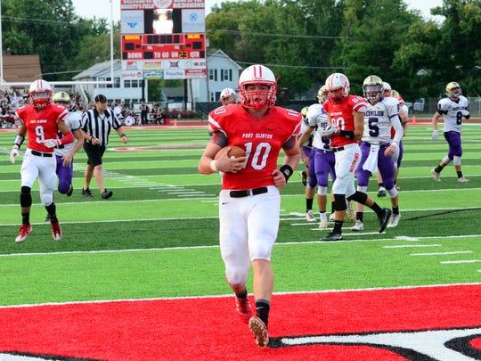 Port Clinton's Joey Brenner scores a touchdown against Vermilion.
