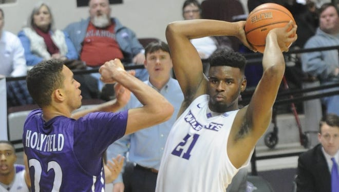 ACU's Jalone Friday (21) looks to pass the ball while Stephen F. Austin's T.J. Holyfield defends. SFA beat the Wildcats 76-66 in the Southland Conference men's basketball game Wednesday, Jan. 17, 2018 at Moody Coliseum.