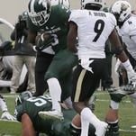 Michigan State running back LJ Scott (3) runs into the end zone for a touchdown during the first half of an NCAA college football game against Purdue, Saturday, Oct. 3, 2015, in East Lansing, Mich. Scott ran for 146 yards and two touchdowns, and No. 2 Michigan State held on to beat Purdue 24-21. (AP Photo/Carlos Osorio)