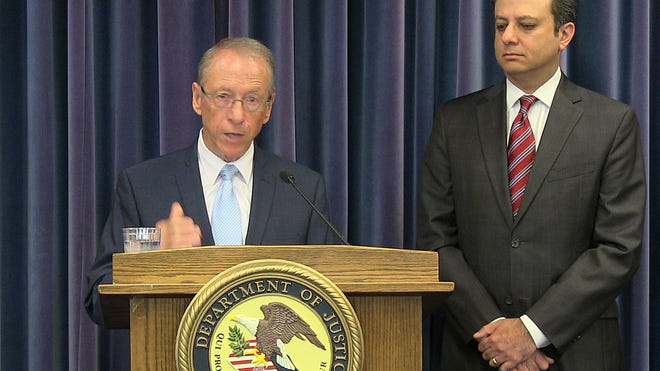 Dutchess County District Attorney William Grady, at podium, and U.S. Attorney for the Southern District of New York Preet Bharara discuss the arrest of two Dutchess County men in the sale of heroin that resulted in the deaths of three people. The news conference was held Thursday at the federal courthouse in White Plains.