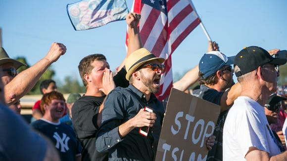 Anti-Islam protesters gather outside a mosque in Phoenix