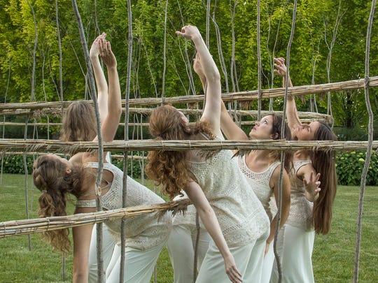 Wild Space dancers perform in and around Roy Staab's sculpture at Villa Terrace.