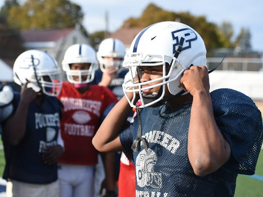 Poughkeepsie's Akili Hill adjusts his helmet during practice at Poughkeepsie High School on Wednesday.