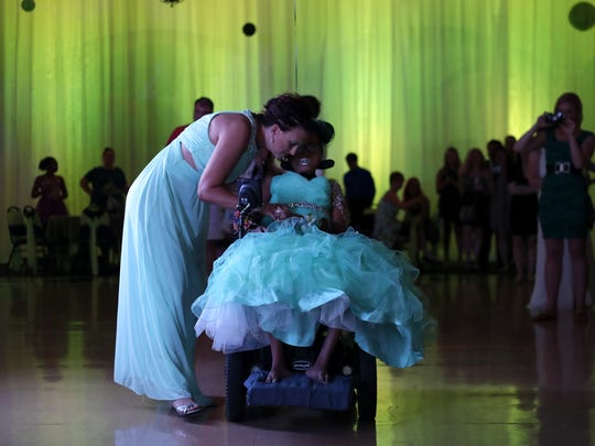 Jen Bolen talks and dances with her daughter Jerika