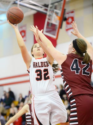 Valders Vikings' Lindsay Glaeser (32) makes a shot during the first half of the game against New Holstein Huskies on Tuesday, Dec. 1. The Vikings defeated the Huskies 65-24.