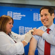 Dr. Tom Frieden, director of the Centers for Disease Control and Prevention, gets his flu shot at a press conference in Washington, D.C., Sept. 18, 2014.