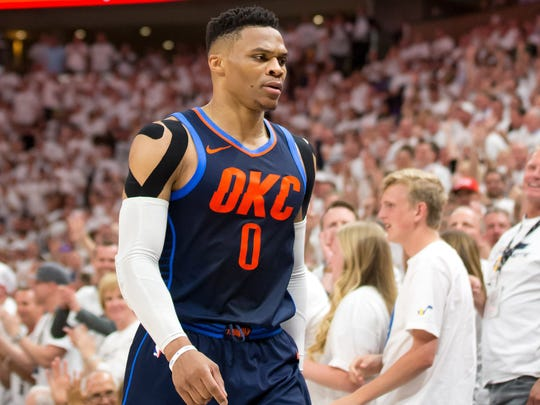 Russell Westbrook heads to the bench after being assessed with his fourth foul against the Jazz.