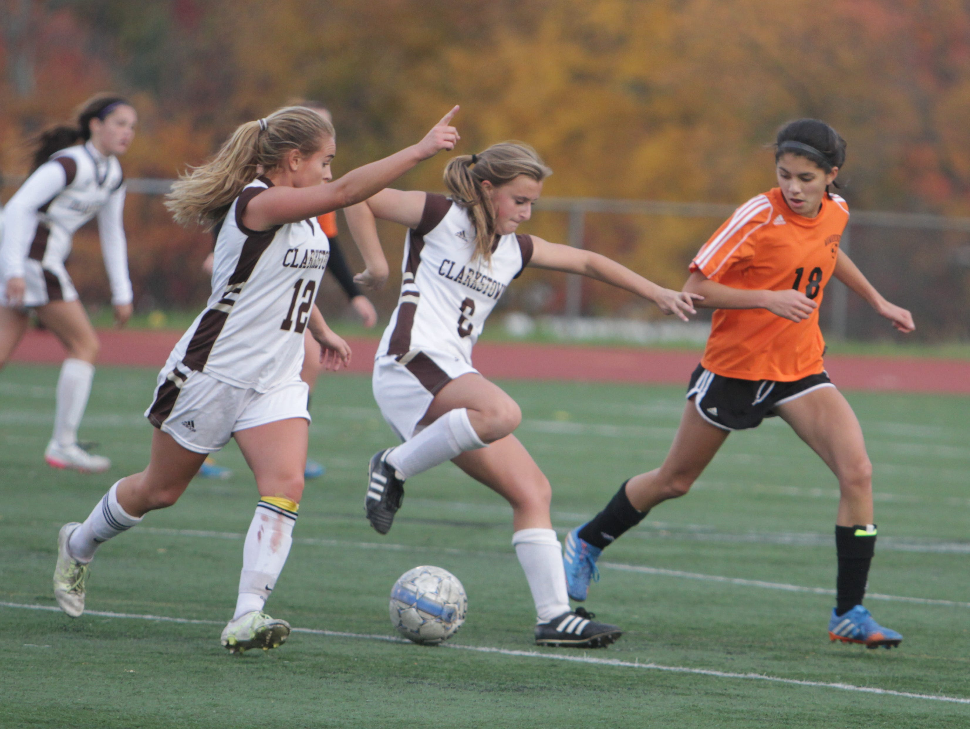 Clarkstown South's Angela Basile (middle) makes a move on Mamaroneck's Lauren Shpiz during a Section 1, Class AA quarterfinal game at Clarkstown South High School on Tuesday, October 27th, 2015. Clarkstown South won 1-0 in overtime.