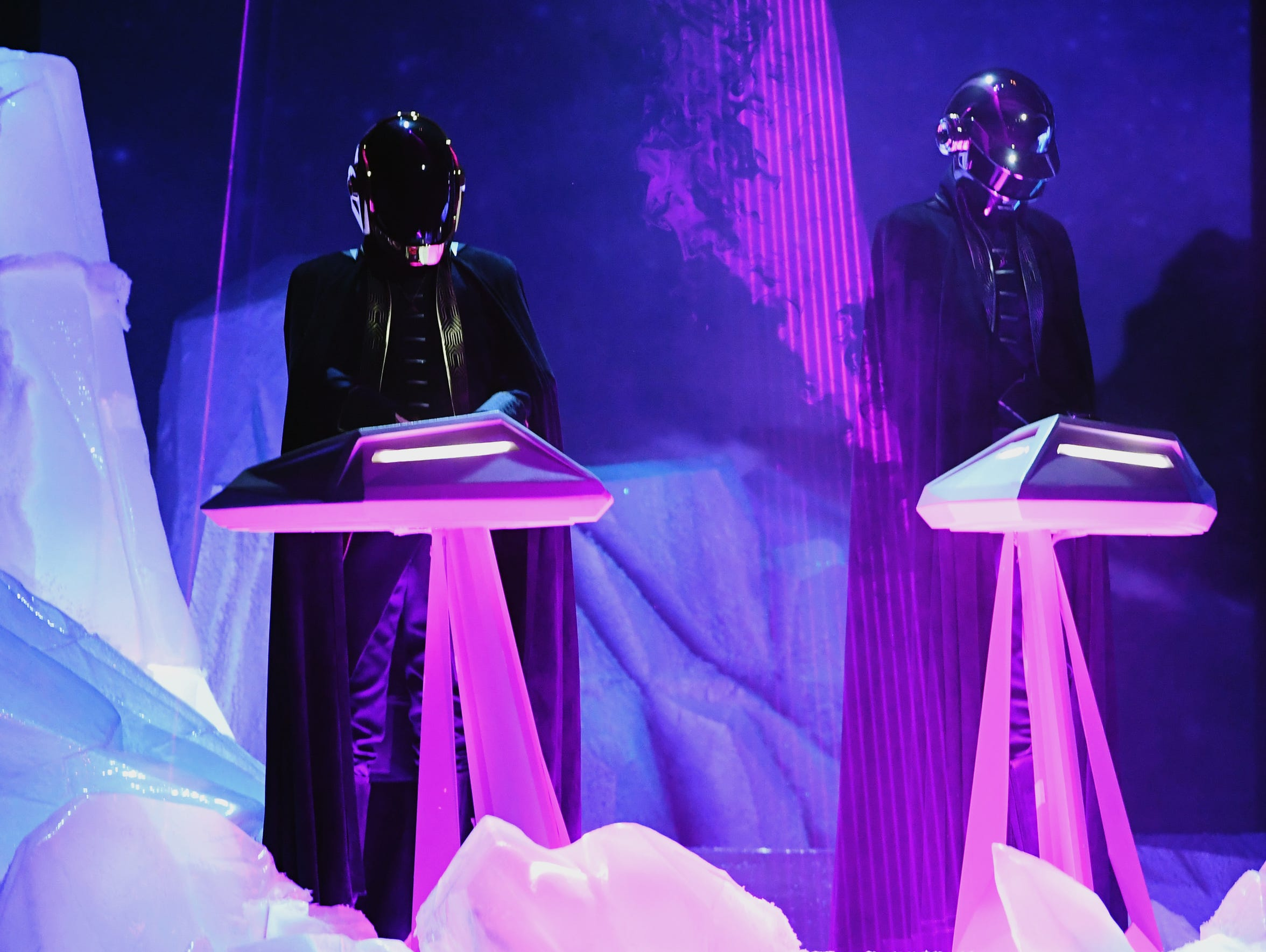 Music group Daft Punk performs onstage during The 59th