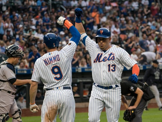 New York Mets center fielder Brandon Nimmo (9) congratulates