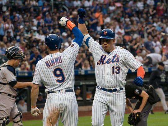 New York Mets center fielder Brandon Nimmo (9) congratulates