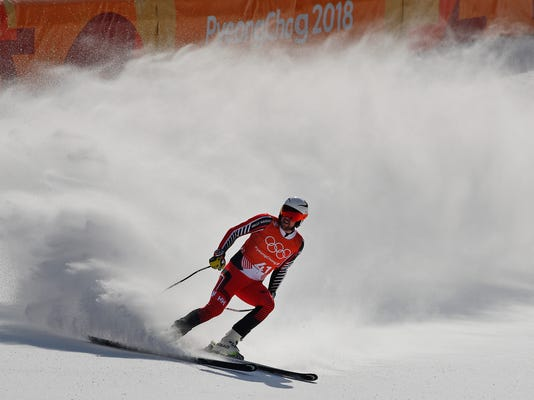 Canada's DustinCook comes to a halt in the finish area to complete men's downhill training at the 2018 Winter Olympics in Jeongseon, South Korea, Friday, Feb. 9, 2018. (AP Photo/Christophe Ena)