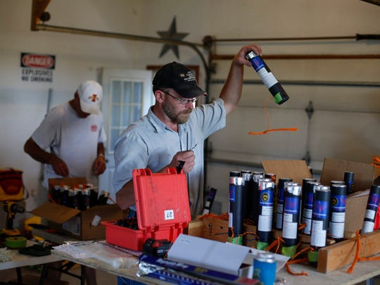 Justin Spade, a pyrotechnic engineer at 4 G's Pyrotechnics, assembles fireworks for the company's 50th anniversary at his home in rural Belmond on Thursday, July 1, 2016. Spade and the other members of the group will celebrate their milestone with a large showcase of fireworks on Monday in Belmond.