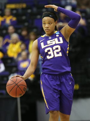 LSU Tigers guard Danielle Ballard (32) motions to her teammates as she drive the ball down court against the West Virginia Mountaineers in the first half of a women's college basketball game in the second round of the NCAA Tournament at the Pete Maravich Assembly Center.