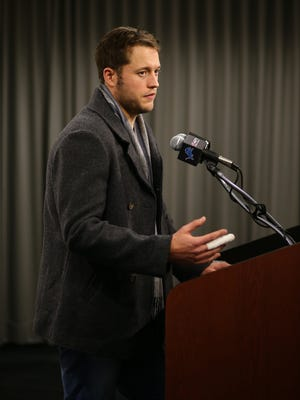 Quarterback Matthew Stafford of the Detroit Lions talks to the media with his right hand taped after defeating the Chicago Bears on Dec. 11, 2016, in Detroit.