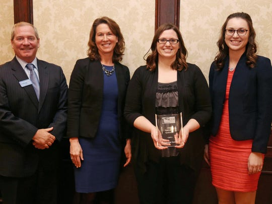 Volunteer of the Year Ashleigh Yonke, third from left, poses with her award at the Spirit of Sheboygan County Volunteer Awards,  Wednesday, April 18, 2018, at the Ostoff Resort in Elkhart Lake, Wis.