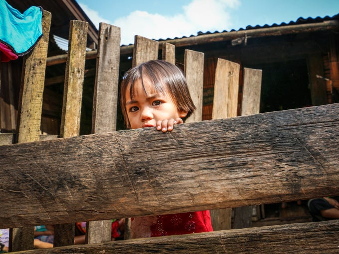A girl plays in a village in the hill country in northern