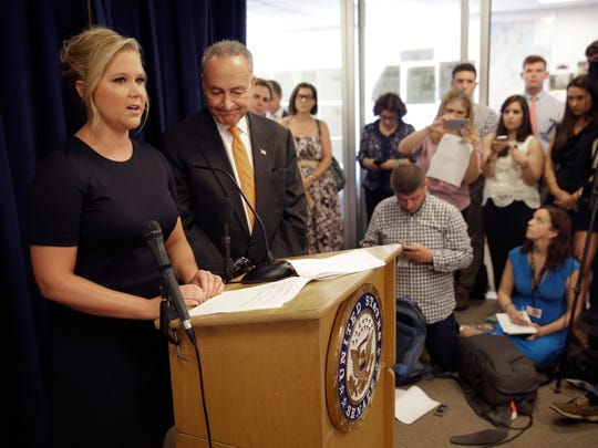 New York Sen. Chuck Schumer, second from right, and his distant cousin, Amy Schumer, left, speak during a news conference in New York, Monday, Aug. 3, 2015.