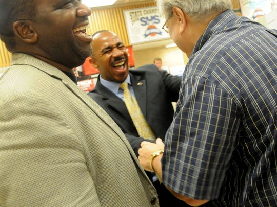 Patrick Williams shares a laugh with people moments after the first forum for Shreveport mayoral candidates event at Southwood High School Tuesday evening.