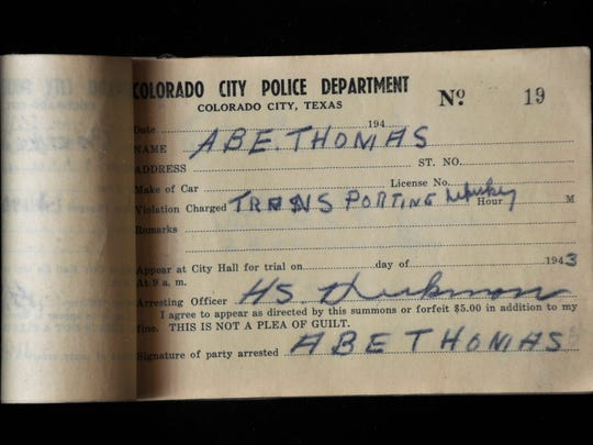 A 1943 citation from former Colorado City Police Chief Dick Hickman, issued for transporting whiskey. The book was on display at the Heart of West Texas Museum Annex Wednesday Sept. 20, 2017.
