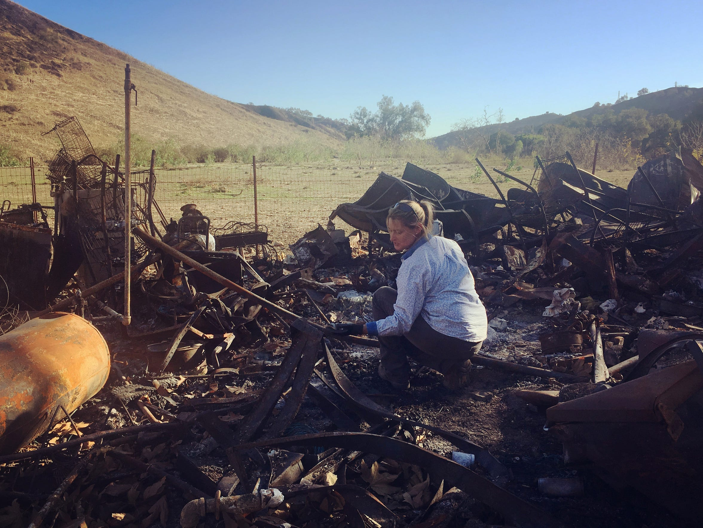 Stacy Hyatt sorts through the remains of her home in