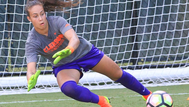 Clemson senior goalkeeper Kailen Sheridan dives for a ball in a drill during practice.