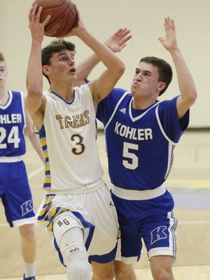 Bryce Pedrin (3) helps lead a balanced Howards Grove attack as the Tigers gear up to face Ozaukee in a WIAA Sectional Semifinal at Sheboygan North on Wednesday.
