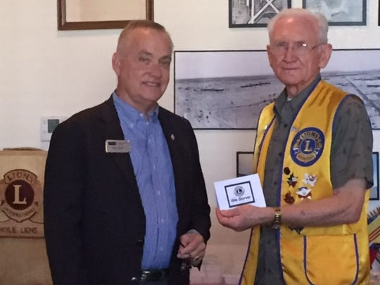 Abilene Founders Lions Club member Gene Goodwin (right) welcomes the club's Oct. 12 guest speaker, Jerry Mash, of Coldwell Banker Panian & Mash Realtors.