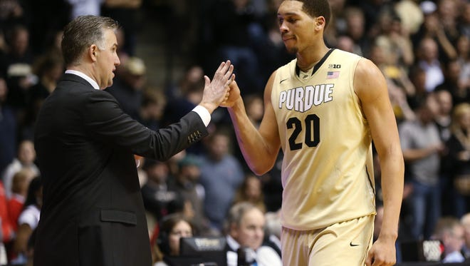 Purdue head coach Matt Painter welcomes center A.J. Hammons back to the bench in the closing seconds of a win over Indiana. Purdue hosted Indiana at Mackey Arena Wednesday, January 28, 2015.