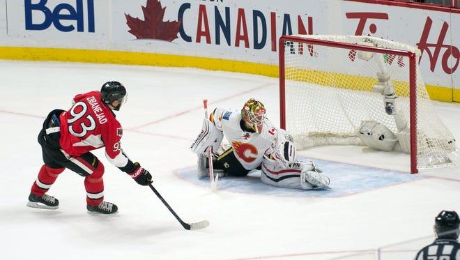 Ottawa Senators center Mika Zibanejad (93) scores against Calgary Flames goalie Joni Ortio (37) in the shootout at Canadian Tire Centre.