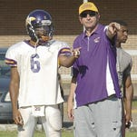 Westminster Christian Academy offensive assistant Brian Ensminger (right) is shown during his days at Hahnville. Ensminger recently joined the WCA staff and plans to help add some veteran guidance as the Crusaders start the 2015 season.