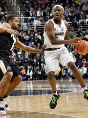 Michigan State guard Cassius Winston not only leads