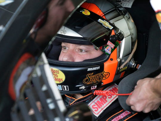 Tony Stewart prepares to take his car out before practice for Saturday's NASCAR Sprint Cup series auto race at Charlotte Motor Speedway in Concord, N.C., Friday, Oct. 9, 2015. (AP Photo/Terry Renna)