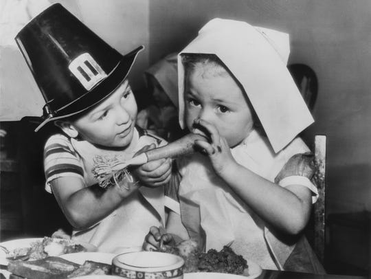 Two children decked out as pilgrims played with their