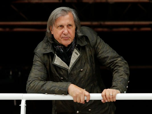 FILE - In this Monday, May 23, 2016 file picture, former Romanian tennis ace Ilie Nastase watches a match of the French Open tennis tournament at the Roland Garros stadium, in Paris, France. Suspended by the International Tennis Federation for his foul-mouthed outbursts, former tennis star Ilie Nastase is now facing a divorce, Romanian media reported Thursday July 13, 2017. (AP Photo/Alastair Grant, File)