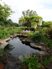 Tim and Jan Jaskoski's garden includes multiple water features including this pond. Their garden will be featured in the 20th Annual Garden Tour May 29-30, which benefits the Gilbert House Children's Museum.