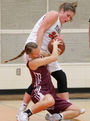 Plymouth's Jessica Leader (34) struggles for ball control with Winneconne's Ashley Brooks (22), Thursday, January 4, 2018, in Plymouth, Wis.
