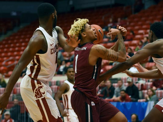 IUPUI guard T.J. Henderson loses control of the ball as Washington State's Kwinton Hinson, left, and Robert Franks, right, defend on the play in the second half of an NCAA college basketball game Saturday, Dec. 16, 2017, in Pullman, Wash. (Pete Caster/Lewiston Tribune via AP)