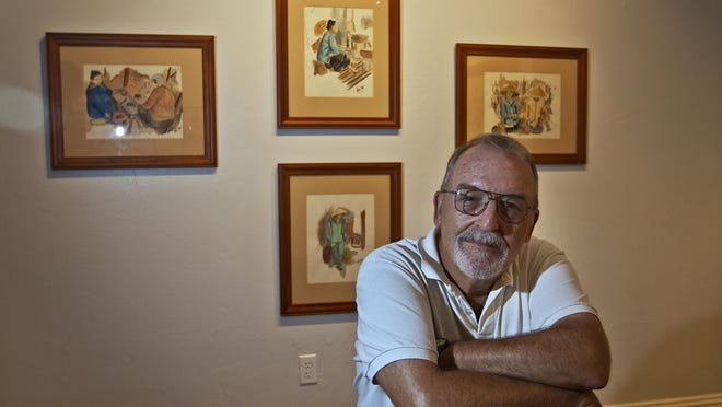 Vietnam veteran and Fort Myers resident Craig Tonjes says making art helps him deal with his PTSD. In the background are four watercolor paintings he contributed to the new John Ebling Veteran Art Gallery at American Legion Post 38 in downtown Fort Myers.
