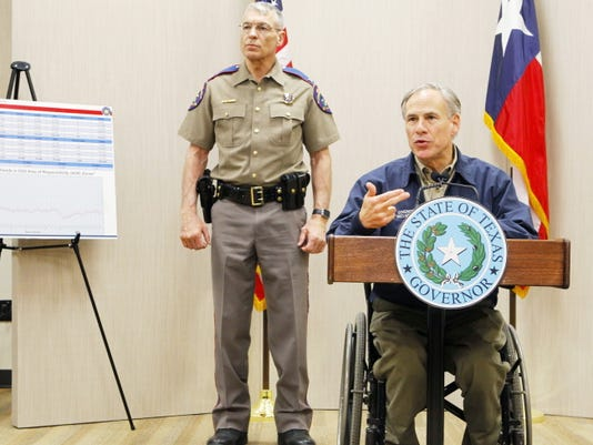 Texas Governor Greg Abbott talks about his border security plan during a news conference as Texas Department of Public Safety Director Steve McCraw stands behind him  March 27 at DPS' Region 3 Headquarters in Weslaco, Texas.