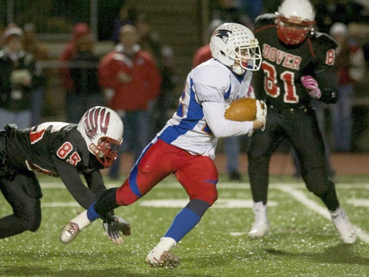 New Oxford running back Wesley Beans breaks through a tackle during a 2013 game.