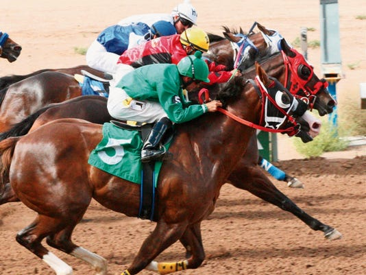 In a four-horse photo finish, Ill Stop The World (red blinkers) got his nose across the wire first in Sunday's La Plata Stakes at Sunray Park and Casino. Jockey Esgar Ramirez (yellow cap) rode the winner, beating Bp Takem Away (inside) and Alis Jumpn (outside), who finished in a deadheat for second, with Tf Featured Effort (between horses) just another neck behind.