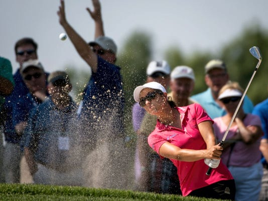 Marina Alex hits a shot out of the bunker on the ninth hole Saturday during the third round of the U.S. Women's Open at Lancaster Country Club. Alex led after the first round but has tumbled out of contention. Saturday's 74 put her at 1-over in a group tied for 18th place.